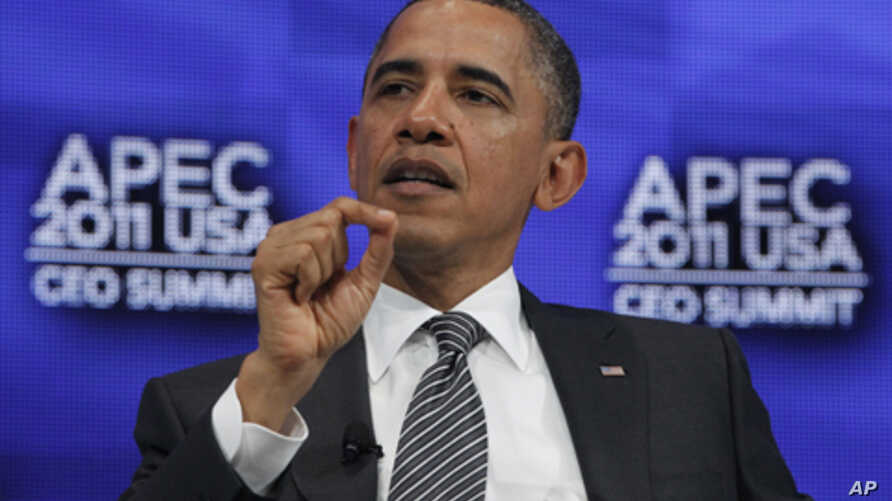 President Barack Obama answers questions from  Boeing Chief Executive Officer Jim McNerney as he attends the APEC CEO Summit in Honolulu, Hawaii, Nov. 12, 2011.
