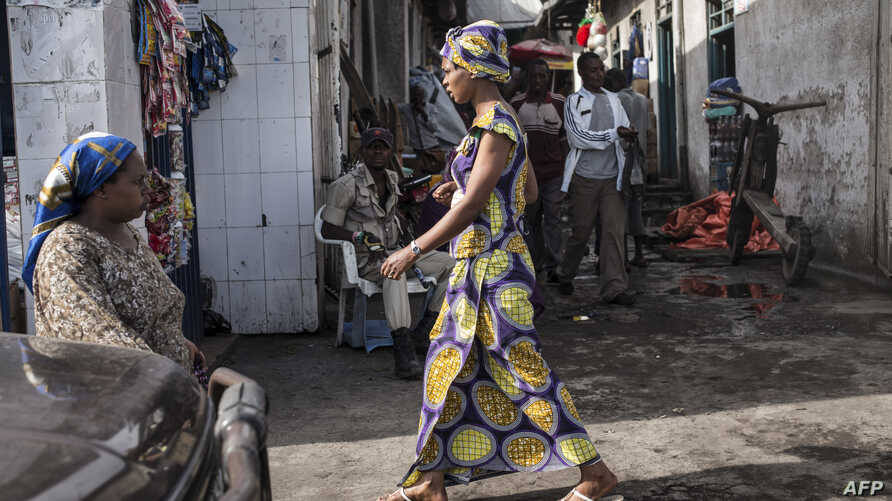 FILE - People walk through the Birere market in Goma,  March 26, 2015.