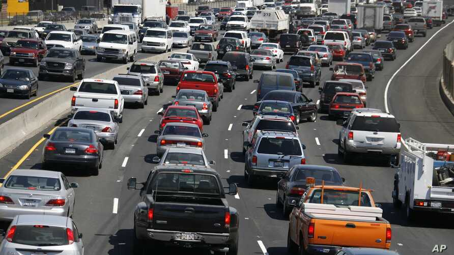 FILE - Southbound traffic on Interstate 5 moves through Los Angeles. Manufacturers are meeting fuel efficiency targets now, but it may get harder as the 2025 deadline gets closer, according to industry analyst Kevin Riddell with LMC Automotive.
