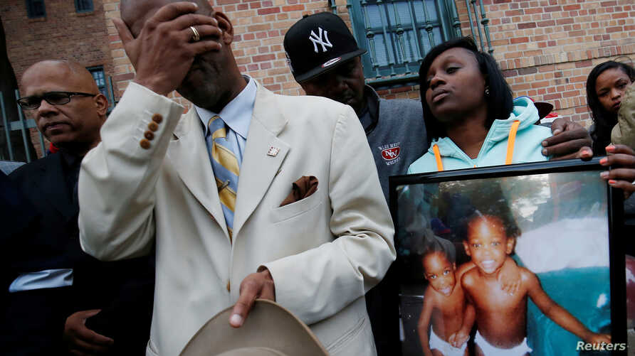 Mourners grieve at a vigil in honor of Edward and Edwin Bryant, twin brothers who were shot and killed in Chicago, Illinois, Oct. 31, 2016.