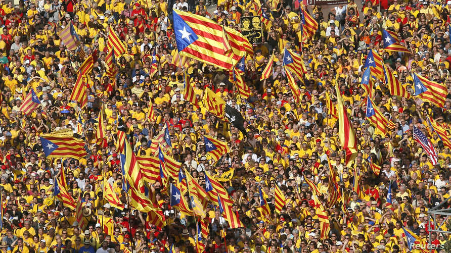 "Catalan pro-independence demonstrators attend a rally at Catalunya square in Barcelona October 19, 2014. Catalonia has dropped plans to hold a referendum on independence from Spain next month but will instead hold a ""consultation of citizens"", the re"