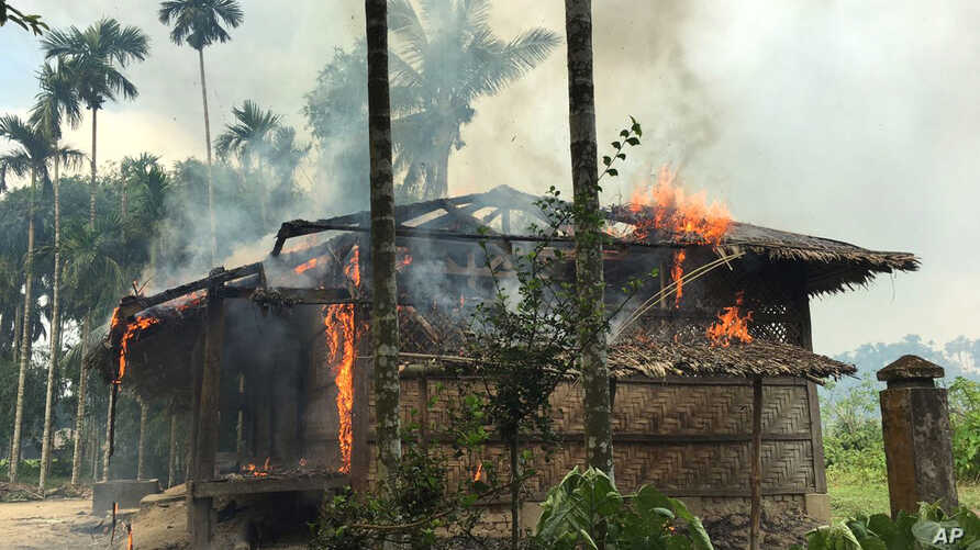 Flames engulf a house in Gawdu Zara village, northern Rakhine state, Myanmar, Sept. 7, 2017. Security forces and allied mobs have burned down thousands of homes in Northern Rakhine state, where the vast majority of the country's 1.1 million Rohingya ...