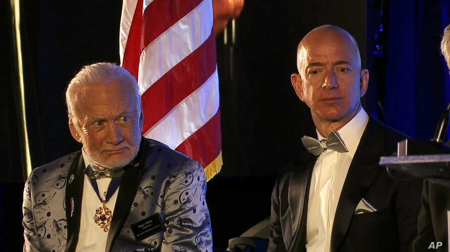 Apollo 11 astronaut Buzz Aldrin, left, and Amazon.com and Blue Origins founder Jeff Bezos attend the commemoration for the upcoming anniversary of the 1969 mission to the moon and a gala for Aldrin's nonprofit space education foundation, ShareSpace F