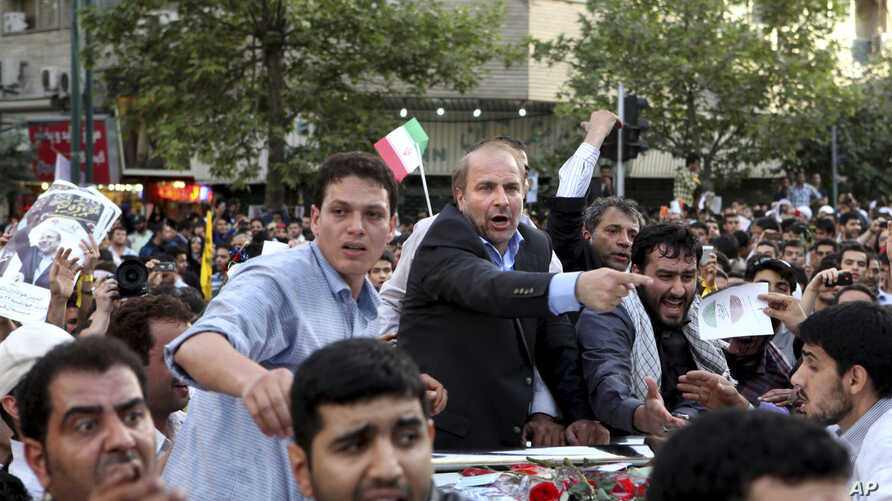 Iranian presidential candidate, Mohammad Bagher Qalibaf, who is also Tehran's mayor, points, during a campaign rally in Tehran, Iran,  June 12, 2013.