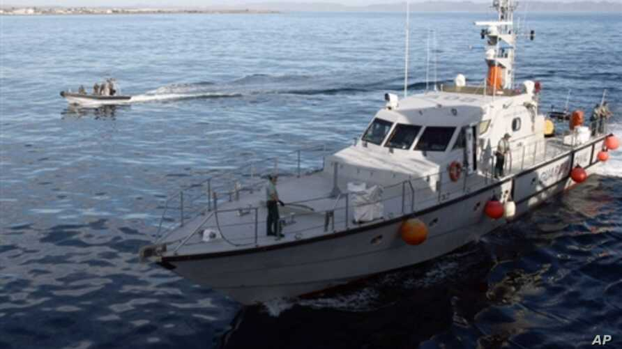 """A Spanish Guardia Civil boat (L) sails near a rapid deployment boat belonging to the French patrol boat Arago involved in a survey operation from Almeria harbor as part of the """"Indalo"""" illegal immigrants drill operation organized by the European Unio"""