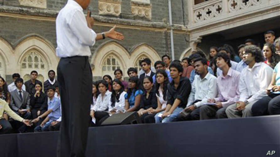 U.S. President Barack Obama on stage as he answers questions during a town hall meeting with students at St. Xavier's College in Mumbai, India, Sunday, Nov. 7, 2010. (AP Photo/Pablo Martinez Monsivais)