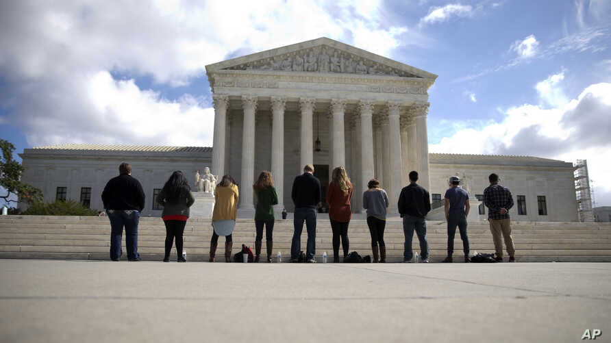 """FILE - Members of """"Bound 4 Life"""" gather in front of the Supreme Court in Washington to protest the ideology of abortion, Oct. 5, 2015."""