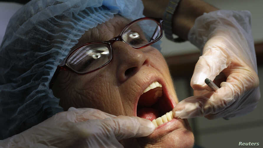 A dentist checks the teeth of a U.S. patient, at a dental clinic in San Jose, November 1, 2012. Around 40,000 medical tourists visited Costa Rica last year, compared to 36,000 in 2010 and 30,000 in 2009. Most of them are American and Canadian, accord