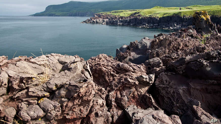 FILE - Lava sediment of the Bogdan Khelmintsky Volcano is seen on Iturup Island, in the Russian Far East, Aug. 21, 2011. Iturup is one of the Kuril Islands, as Russia calls them. Japan refers to them as the Northern Territories.