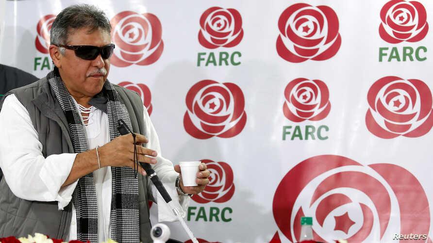 Colombia's Marxist FARC Jesus Santrich gestures during a news conference in Bogota, Colombia Nov. 16, 2017.