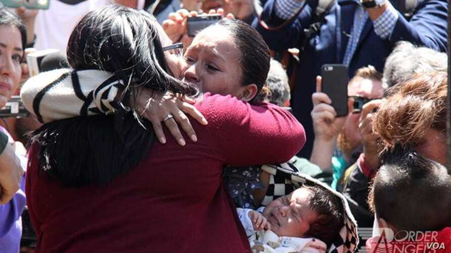 Gabriela Esparza was able to hug her mother and sister on May 1 during a symbolic event when an emergency door at the U.S.-Mexico border in California was opened for a brief time.