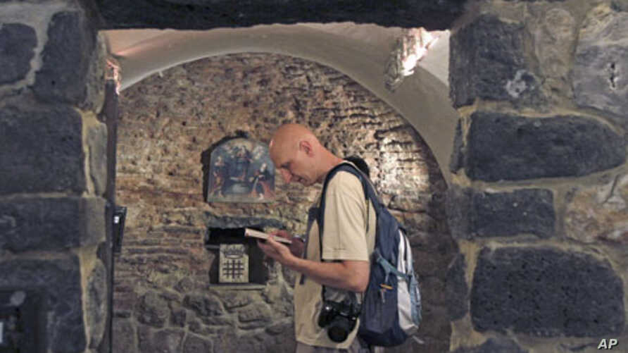A tourist visits the St. Ananias church, dating back to the first century, in Damascus June 3, 2010 (file photo)