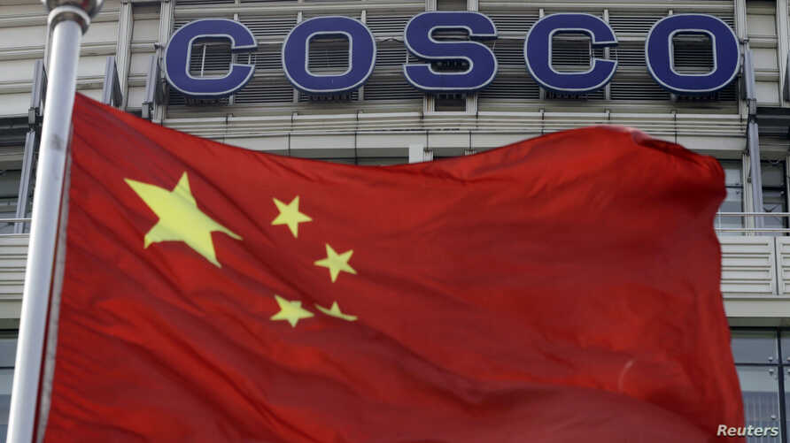 A Chinese national flag flies in front of COSCO's headquarters in Beijing Aug. 26, 2010.