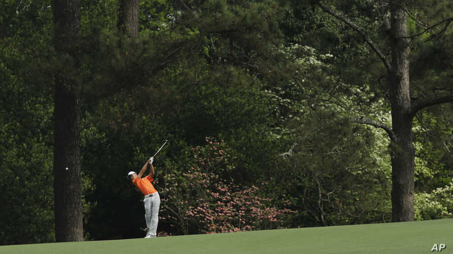 Amateur Guan Tianlang, of China, hits off the second hole during the second round of the Masters golf tournament in Augusta, Georgia, April 12, 2013.