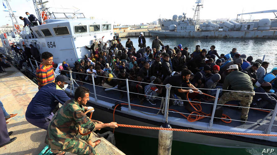 Migrants of different African nationalities arrive at a naval base in the Libyan capital Tripoli, April 22, 2018, after being rescued off the coast of Zliten from two inflatable boats.