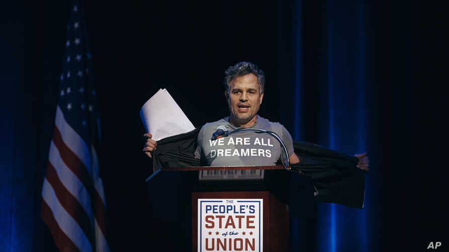 """Mark Ruffalo shows his T-shirt reading """"We are all dreamers"""" during the """"People's State of the Union"""" event at The Town Hall in New York, Jan. 29, 2018."""