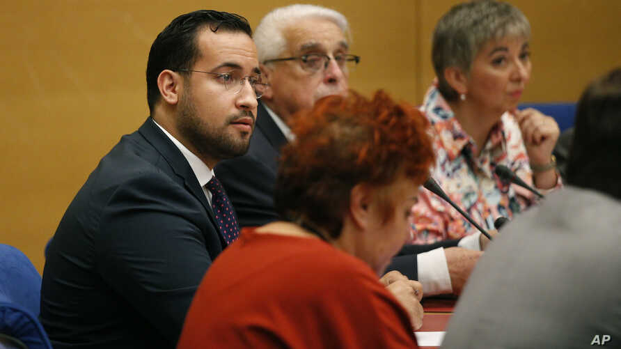 Former President Macron's security aide Alexandre Benalla (L) appears before the French Senate Laws Commission prior to his hearing, in Paris, France, Sept. 19, 2018.