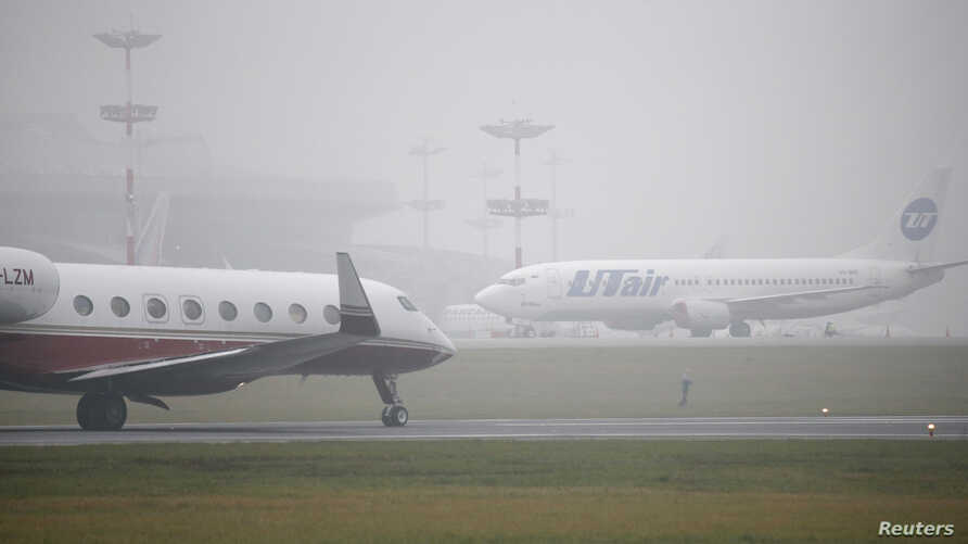 FILE - Planes are seen on the tarmac at Moscow's Vnukovo airport.