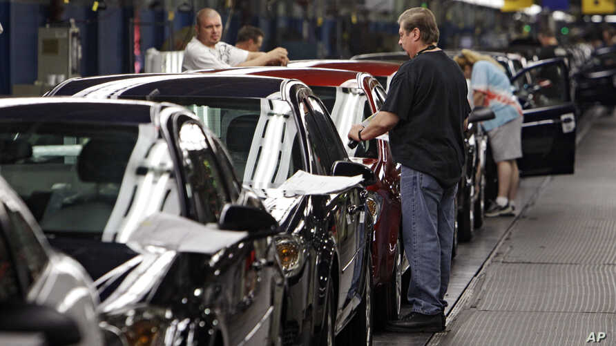 FILE - In this June 15, 2010, file photo, workers at General Motors' plant in Lordstown, Ohio put the final touches on new vehicles.