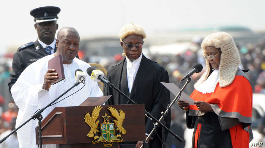 Ghanaian President John Mahama is sworn-in by Chief Justice Georgina Wood (R) at Independence Square, Accra, January 7, 2013.