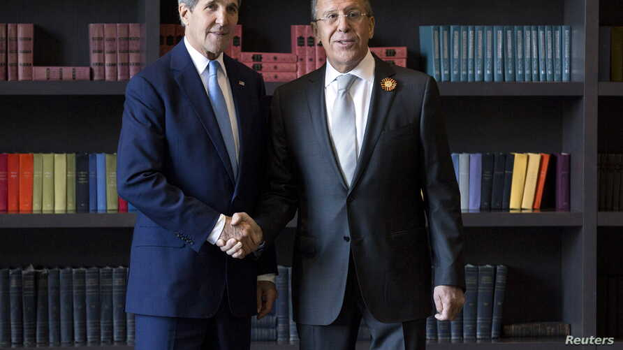 U.S. Secretary of State John Kerry (L) shakes hands with Russian Foreign Secretary Sergey Lavrov before a bilateral meeting in Sochi, Russia, May 12, 2015.