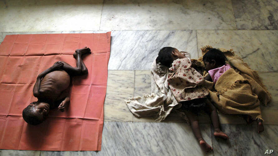 (FIle) HIV-positive Arun, 3, left, HIV positive-Gopika, 2, center, and reportedly HIV-positive Subiksha, 4 months old, lie at the Community Health Education Society (CHES) orphanage in Chennai, India.