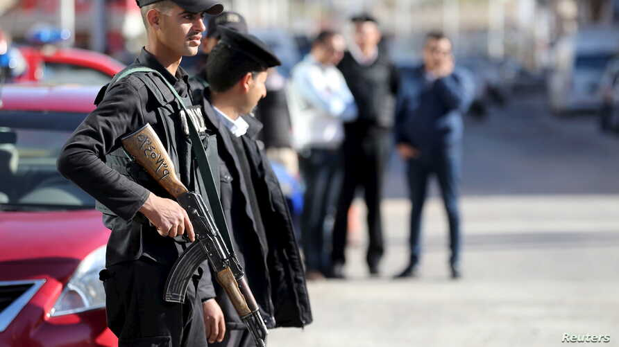 Egyptian security personnel guard the entrance to the Bella Vista Hotel in the Red Sea resort of Hurghada, Egypt, January 9, 2016. Two armed assailants attacked the hotel in the Egyptian Red Sea resort town of Hurghada on Friday, wounding three forei