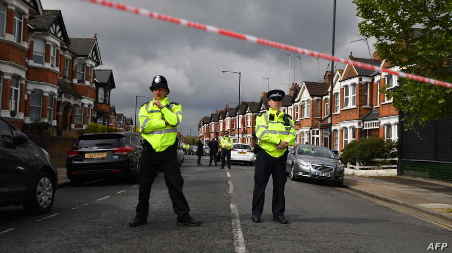 British police officers secure a cordon in a residential street in north-west London on April 28, 2017 where firearms officers shot a female subject after they carried out a specialist entry into an address as part of a Counter Terrorism investigatio