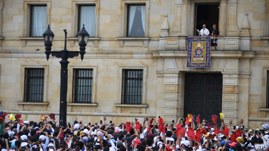 Pope Francis stands over the crowd from Cardinal's Palace where he is to give a blessing at Bolivar Square in Bogota, Colombia, Sept. 7, 2017.