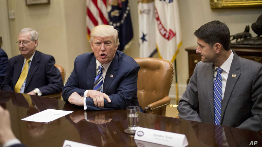 FILE - President Donald Trump, with Senate Majority Leader Mitch McConnell of Kentucky, left, and House Speaker Paul Ryan of Wisconsin, speaks during a meeting with congressional leaders in the Roosevelt Room of the White House in Washington, June 6,...