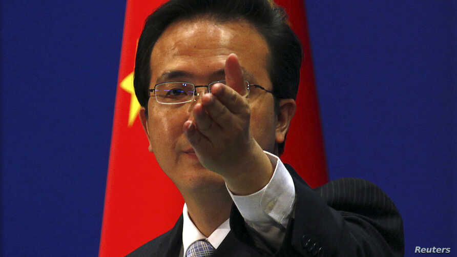 "China's Foreign Ministry spokesman Hong Lei (seen here in a file photo) called the survey which found that a quarter of US firm in China face data theft, ""completely irresponsible."" (Reuters)"