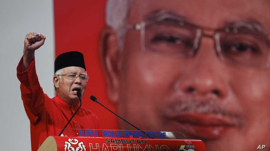 FILE - Malaysian Prime Minister Najib Razak addresses delegates during his speech at the Malaysia's ruling party United Malays National Organization's (UMNO) anniversary celebration.
