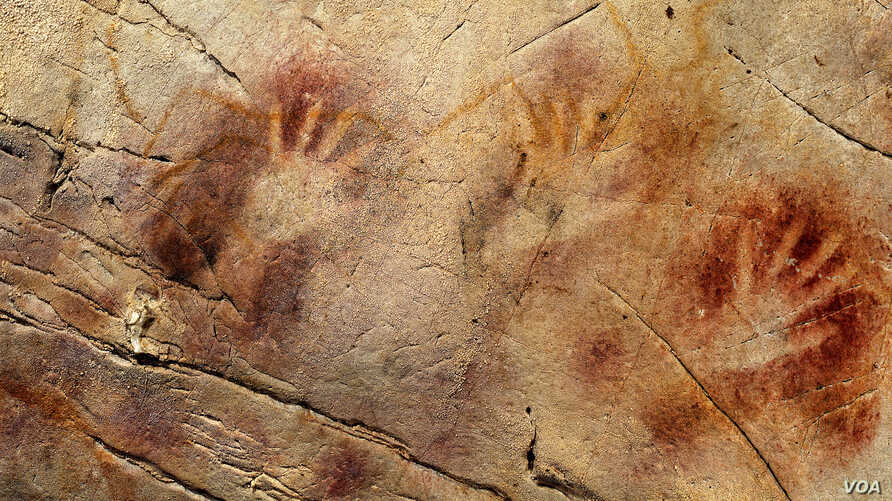 Hand prints dating from 37,000 years ago, and a red disk from 40,600 years ago (not pictured), in El Castillo Cave in Spain are the oldest cave paintings in Europe. (Pedro Saura)