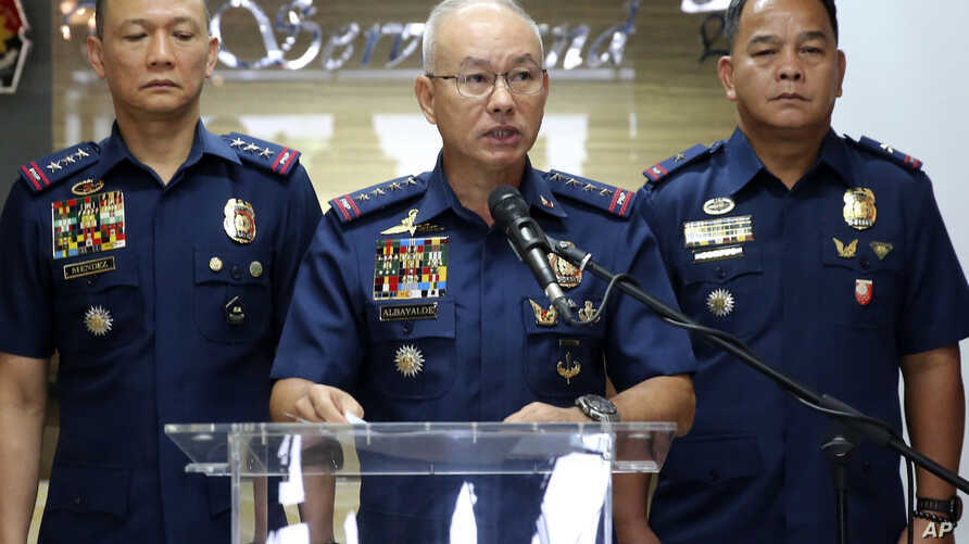 Director General Oscar Albayalde, center, Chief of the Philippine National Police at Camp Crame in suburban Quezon city northeast of Manila, Philippines, , Monday, Feb. 4, 2019.