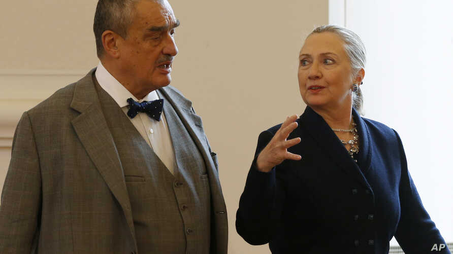 Czech Republic's Foreign Minister Karel Schwarzenberg, left, and US Secretary of State Hillary Rodham Clinton, right, arrive for their press conference in Prague, Czech Republic, Dec. 3, 2012.