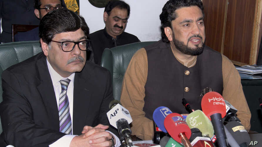 Pakistani Minister of State for Interior Shehryar Afridi, right, and Pakistan's Interior Secretary Azam Suleman Khan give a press conference in Islamabad, March 5, 2019.