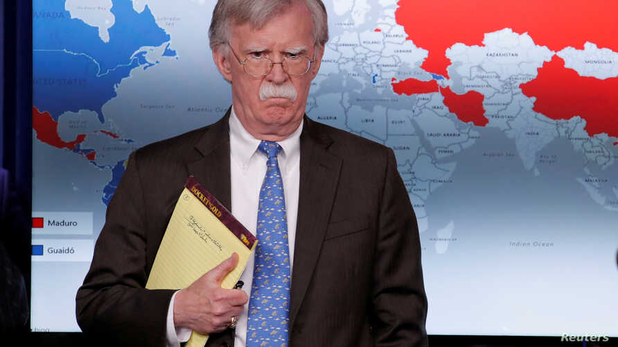 FILE - U.S. National Security Adviser John Bolton arrives to address reporters as the Trump administration announces economic sanctions against Venezuela during a press briefing at the White House in Washington, Jan. 28, 2019.