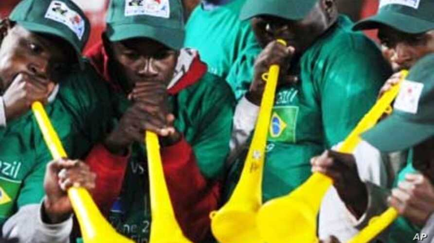 South African fans blow vuvuzelas in support of Brazil at last year's Confederations Cup in South Africa. .Football fans around the world want the instruments banned at the forthcoming World Cup