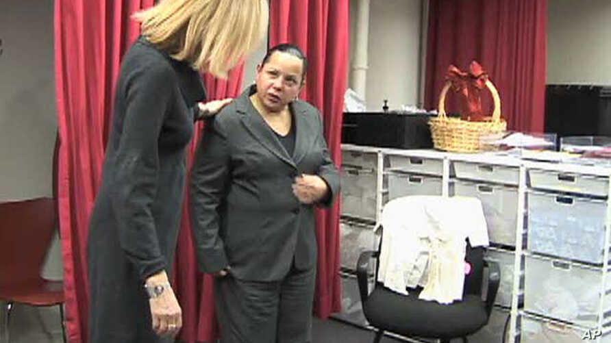 Staffer at Dress for Success helps Marty Sanabria with a dress