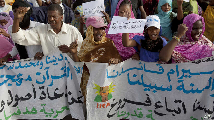 FILE - Mauritanian anti-slavery protesters march to demand the release of imprisoned abolitionist leader Biram Ould Abeid in Nouakchott, May 26, 2012. Slavery still exists in some parts of Mauritania despite a 2007 law banning the practice.