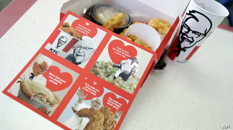 Valentine's Day scratch-and-sniff cards, which give off a fried chicken aroma, sit on a table at a KFC in Santa Clara, California, Feb. 13, 2018.