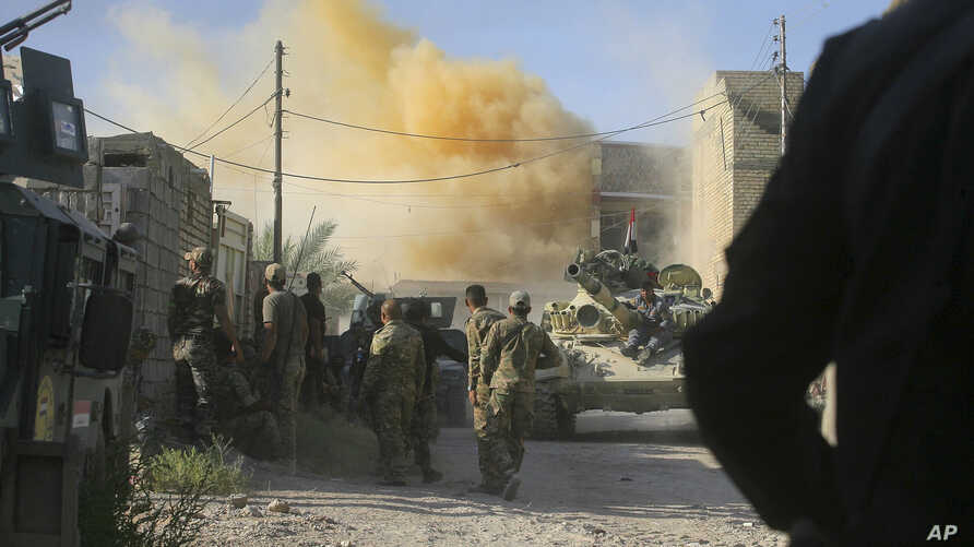 FILE - Smoke rises after an airstrike by a U.S.-led coalition warplane as Iraqi security forces advance their position during heavy fighting against Islamic State militants in Fallujah, Iraq, June 14, 2016.