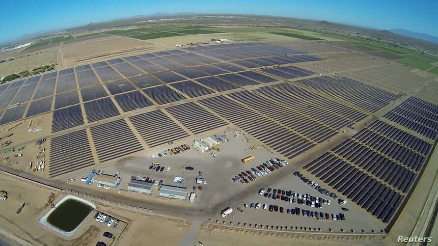 Apple's 50-megawatt solar farm, east of Apple's data center in Mesa, Arizona, is pictured in this undated handout photo obtained by Reuters on April 9, 2018.