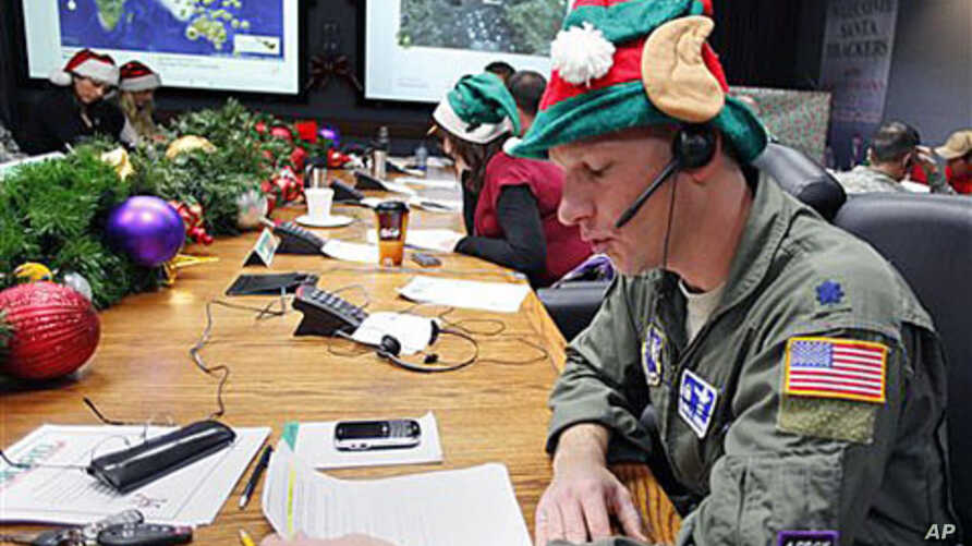 Air Force Lt. Col. David Hanson, of Chicago, takes a phone call from a child in Florida at the Santa Tracking Operations Center at Peterson Air Force Base near Colorado Springs, Colorado, December 24, 2010.
