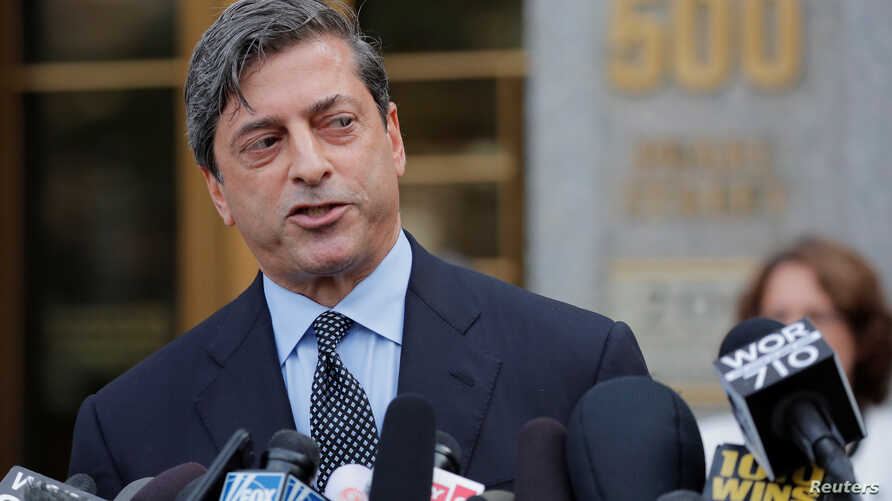 FILE - U.S. Deputy Attorney Robert Khuzami speaks to the media outside the the Daniel Patrick Moynihan United States Court House after U.S. President Donald Trump's former lawyer, Michael Cohen, plead guilty to eight criminal counts in lower Manhatta