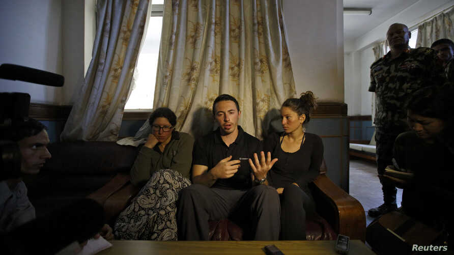 Israeli trekkers Maya Ora (R) along with Yakov Megreli (C) and Linor Kajan (L), who were rescued from an avalanche by the Nepalese army, speak with the media while undergoing treatment at the Army Hospital in Kathmandu, Nepal, Oct. 16, 2014.