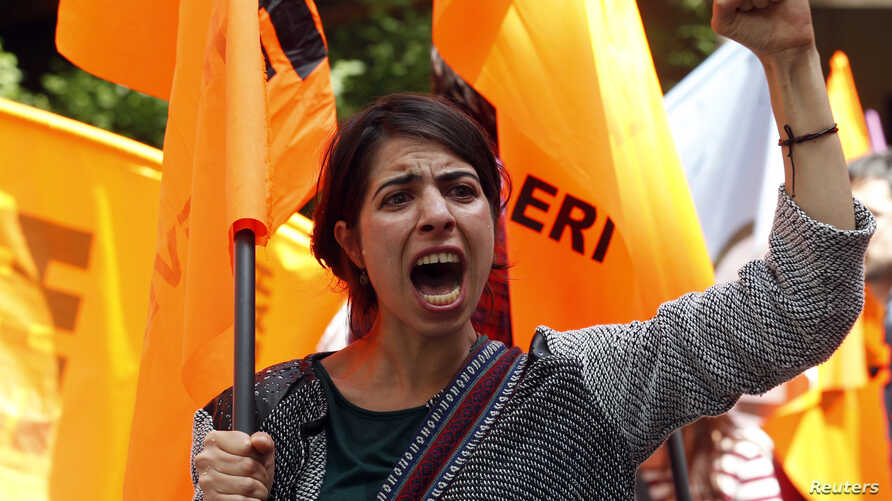 A protester shouts slogans against Turkey's Prime Minister Recep Tayyip Erdogan and his government's policy on Syria, during a demonstration in Ankara in this May 18, 2013, file photo.