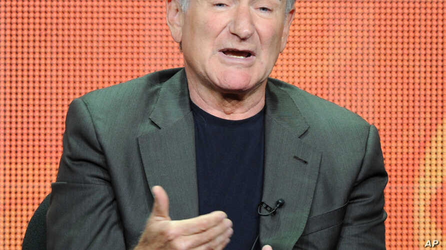 """FILE - In this July 29, 2013 file photo, actor Robin Williams participates in the """"The Crazy Ones"""" panel at the 2013 CBS Summer TCA Press Tour at the Beverly Hilton Hotel in Beverly Hills, California."""
