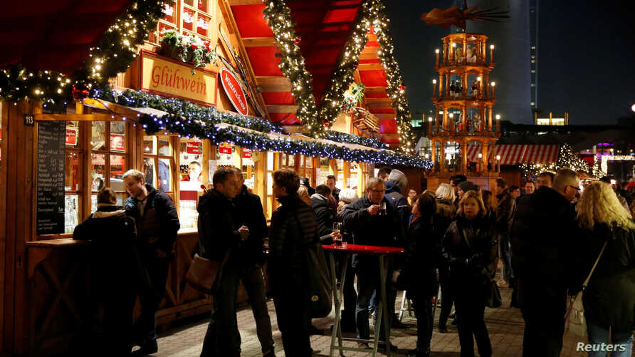 People visit the Christmas market near Alexanderplatz square in Berlin, Germany, Nov. 23, 2016.  Officials say a boy allegedly tried to detonate a bomb at a holiday market in the southern city of Ludwigshafen last month.