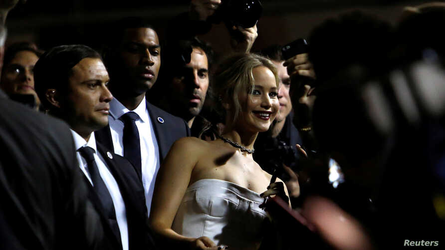 """Cast member Jennifer Lawrence poses with fans at the premiere of """"Passengers"""" in Los Angeles, California, US, Dec. 14, 2016."""